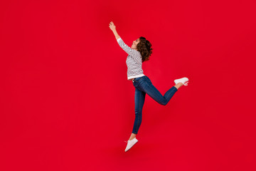 Full length size body photo of fly high in delight with invisible umbrella holding it by hands glad attractive she her girl wearing white casual sweater on red vivid bright background