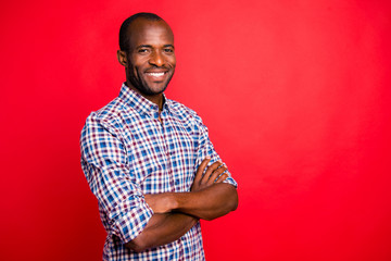 Profile side view portrait of nice handsome well-groomed trendy attractive cheerful positive cheery guy wearing checked shirt beaming smile isolated over bright vivid shine red background