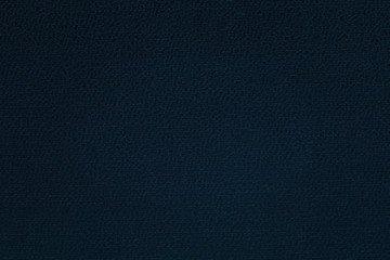 dark blue cardboard surface texture close-up mysterious background