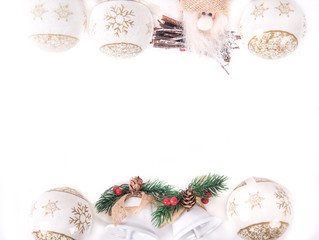 a santa claus decoration with som christmas balls on a white background