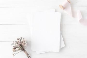 Feminine wedding, birthday desktop mock-up. Invitation card mockup, template  White wooden background. Flat lay, top view. Minimal, clean modern