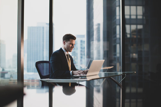 Businessman working in executive office in a skyscraper
