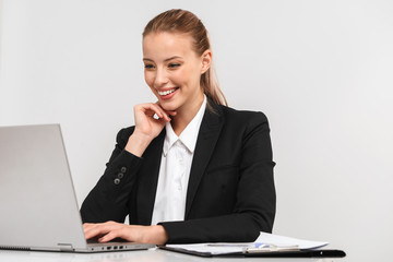 Pretty young business woman wearing suit isolated