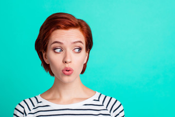 Close-up portrait of nice funny charming attractive lovely sweet red-haired lady in striped pullover air blow pouted lips looking aside isolated over bright vivid shine green turquoise background Fototapete