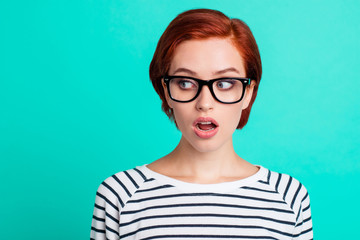 Headshot photo portrait of staring aside to the left copy space amazed shocked with shirt hairstyle raised eyebrows she her person in modern apparel isolated teal vivid background
