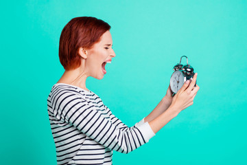 Half turned photo portrait of aggressive rage exhausted loud noisy she her lady holding trying to brake floor holding with sound alarm watch isolated turquoise background