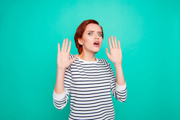 Leave me alone! Unhappy worried troubled she her lady student gesturing palms going away wearing black white pullover isolated turquoise background