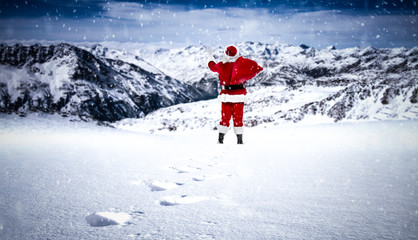 Winter landscape of mountains and Santa Claus