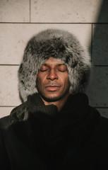 Adult black man in stylish warm clothes
