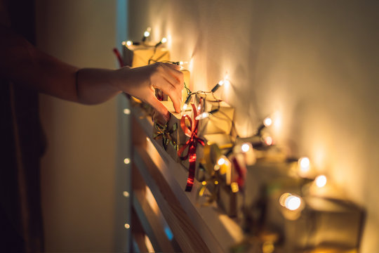 Mom makes an advent calendar for a child - a son or daughter on the headboard
