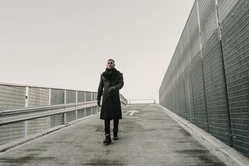 Stylish black man walking on street