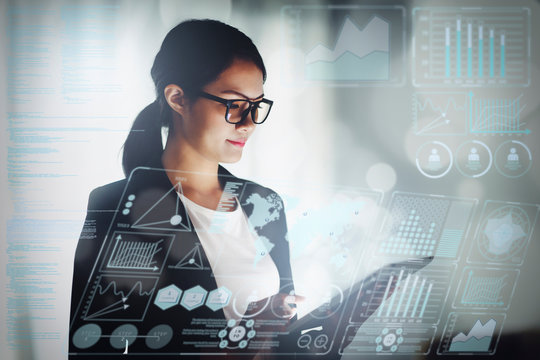 young business woman working in office with tablet