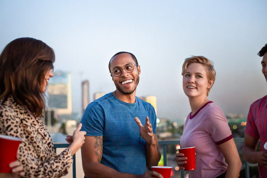Group of friends dancing at a rooftop party