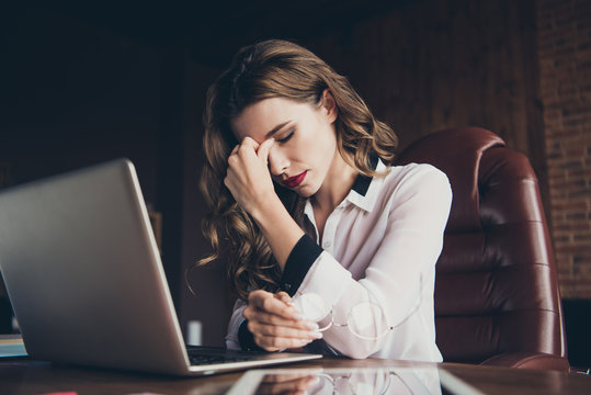 Profile side view portrait of nice attractive glamorous sad minded wavy-haired lady professional executive manager touching face in front of laptop at work place station