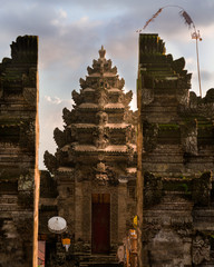 Aligned balinese split gate and candi entrance in Pura Kehen hindu temple, Bali, Indonesia.