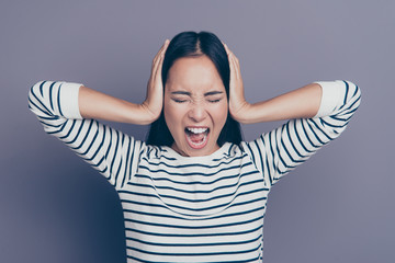Close up portrait of yelling amazing brunette she her girl can't stand with pain eyes closed hands hiding ears painful wearing white pullover isolated on grey background