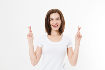Young woman cross fingers for wishing good luck isolated on white background.Template summer t shirt. Copy space