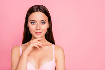 Close up portrait of attractive gorgeous tender brunette finger touching chin showing rejuvenation result her she woman wearing pale pink bra isolated on rose background