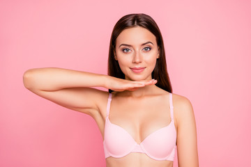 Close up portrait of attractive gorgeous gentle tender hand up touching chin showing correction influence her she woman wearing pale pink bra isolated on rose background