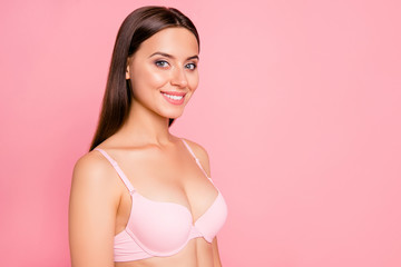 Half turned close up photo of glad gorgeous beautiful tenderness she her woman breast cleavage wearing pale pink bra flawless isolated on rose background