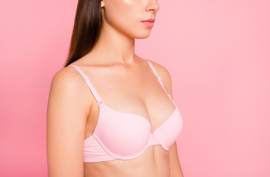 Cropped half turned close up photo of healthy stunning seductive breast she her woman dressed in pale pink bra flawless isolated on rose background