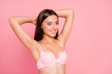 Portrait of nice cute attractive lovely sweet delicate tender cheerful healthy girl in beige bra perfect shape form line curves chest enjoying lifestyle isolated over pink pastel background