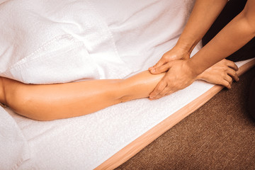 Top view of a female hand during oil massage