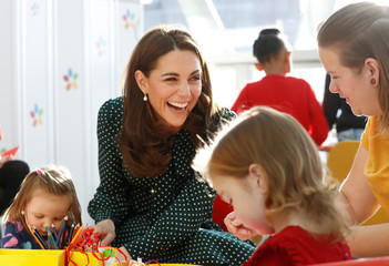Britain's Catherine, the Duchess of Cambridge, meets children during a visit to Evelina London Children's Hospital in London