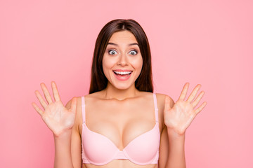 Close-up portrait of her she nice lovely attractive charming cheerful positive funky optimistic girl in beige bra showing palms staring isolated over pink pastel background