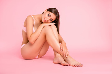 Full length body size photo of sitting on floor tender gorgeous attractive tempting she her girl with groomed feet foot hands with great figure shape in pale pink bra isolated on rose background Wall mural