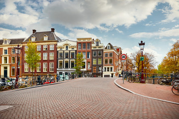 Stores à enrouleur Amsterdam Amsterdam, Netherlands. Bridge with bicycles along road on water