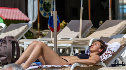 Young woman relaxing on a beach in French Riviera