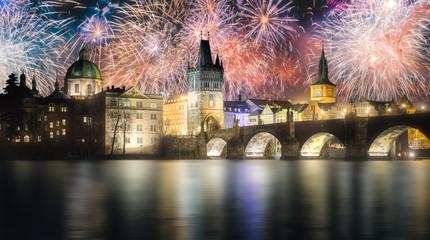 Beautiful fireworks above Charles bridgeat at night, Prague, Czech Republic