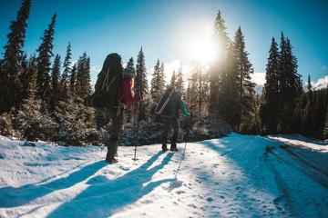 Two women in a winter hike.