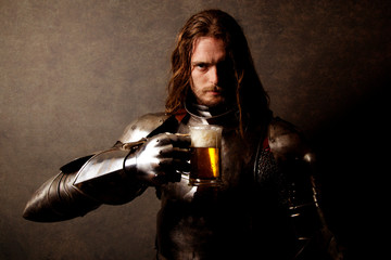 Portrait of a knight in armor drinking a beer Wall mural