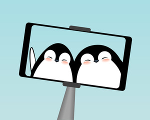 Winter cute penguins selfie on smartphone.