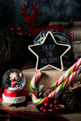 gifts, ornaments and text enjoy the holiday
