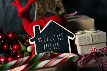 christmas ornaments and text welcome home