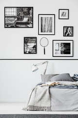 Photo collector bedroom with king size bed with grey bedding and white lamp