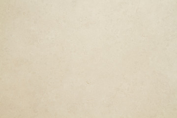 Beige colored tiled wall texture or background