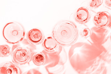 Many glasses of rose wine at wine tasting. Concept of rose wine and variety . Living coral theme - color of the year 2019