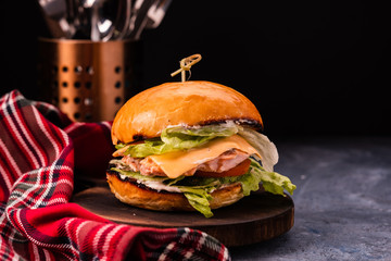 Fish burger with grilled salmon, cheese and vegetables.