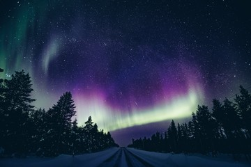 Tuinposter Noorderlicht Colorful polar arctic Northern lights Aurora Borealis activity in winter Finland