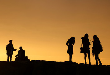 silhouettes of children playing on the beach