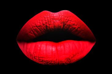 Red lips. Sensual lips in black background. Sexy texture lips and matte lipstick. Purple matt lipstick. Lip isolated.