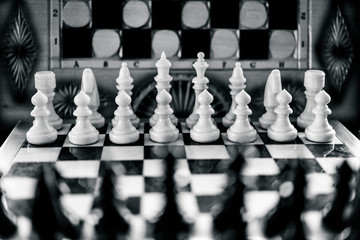 White chess figures on the background of a chessboard