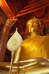 Big Buddha statue, Luang Pho To, in red temple of Phanan Cho Temple, Thai public temple.