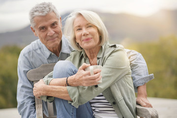 Loving portrait of modern senior couple outdoors