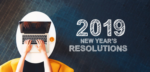 2019 New Years Resolutions with person using a laptop on a white table