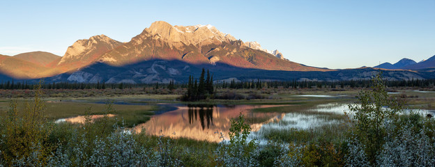 Beautiful panoramic landscape of the Canadian Rocky Mountains during a sunny sunrise. Taken in Jasper National Park, Alberta, Canada.